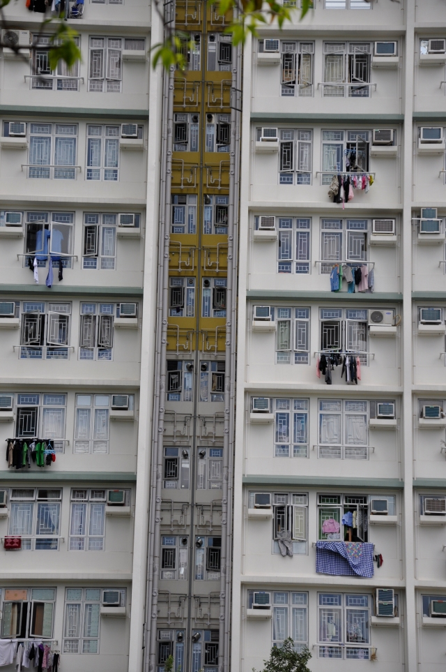 The plumbing chases on high-rise residential buildings are usually visible to any person and clothes are can be hung outside the window.